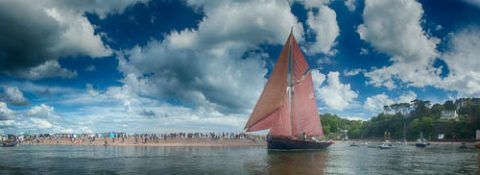 Photo of a sailing boat on the River Teign