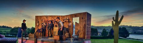 Photo of a group of actors from the Miracle Theatre performing on stage in Hearn Field, Combeinteignhead