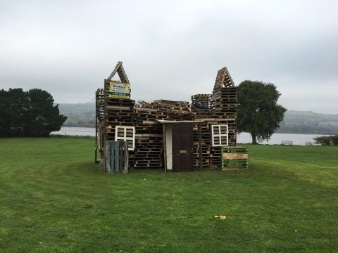 The bonfire, built in the shape of a house, on Hearn Field