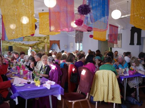 Photo of the diners at the Bollywood evening at Combeinteignhead village hall