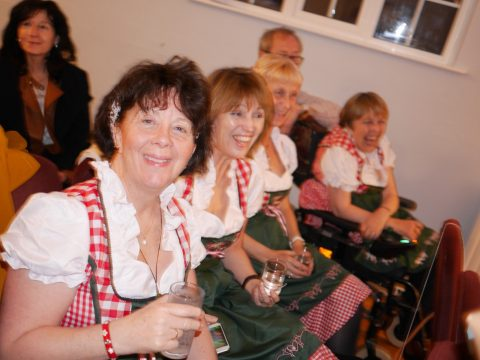 Photo of several ladies enjoying themselves at the Singalone-a-Sound-of-Music evening at Combeinteignhead village hall