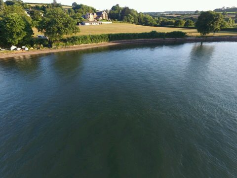 Aerial view of Hearn Field taken from the River Teign