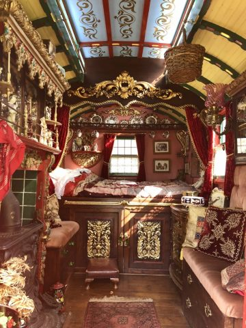 Photograph of the interior of a restored Romany gypsy caravan